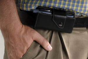 Man Wearing A Smartphone In A Leather Belt Cradle