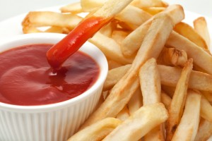 Ketchup with french fries dipped