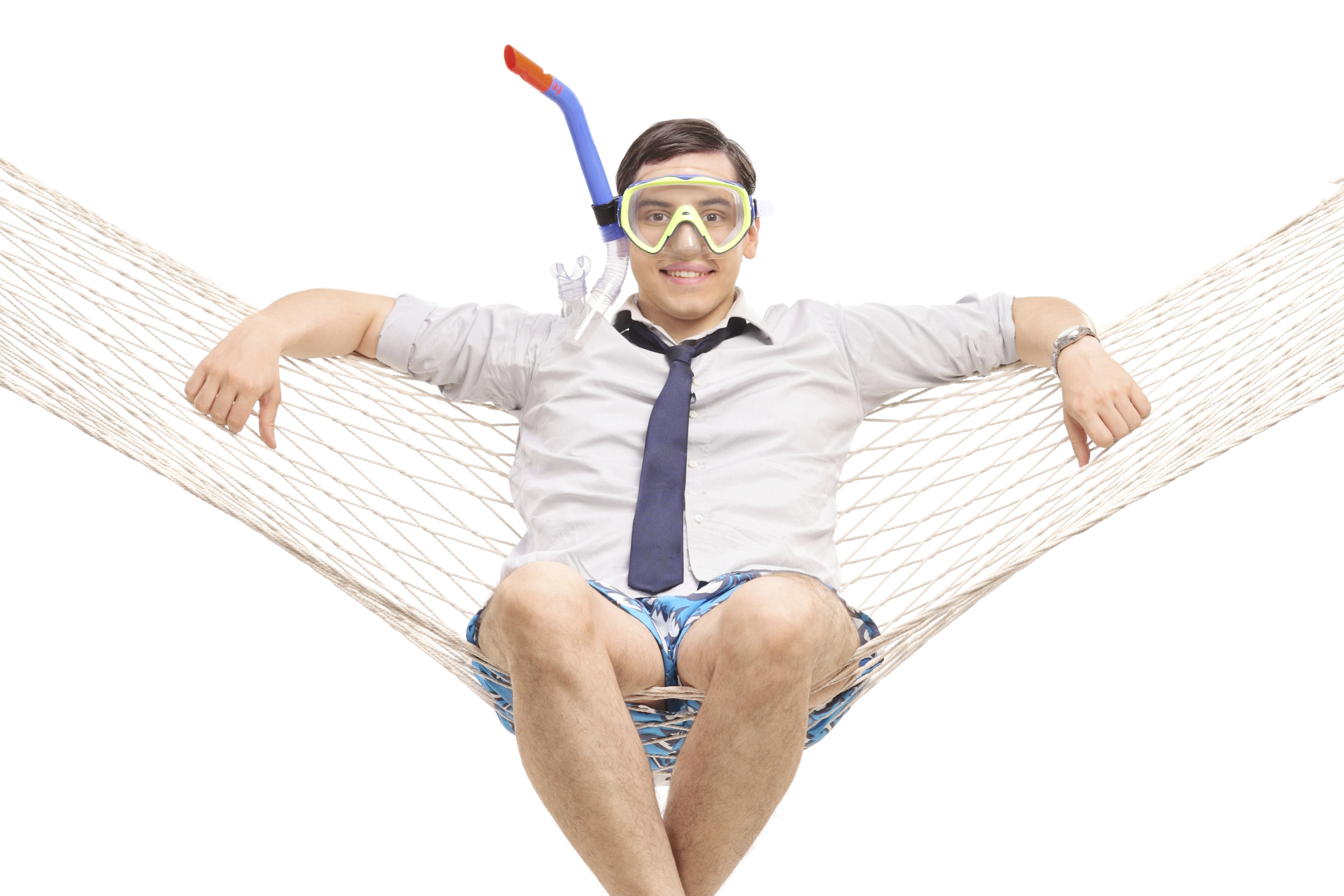 Young man with a snorkeling mask lying in a hammock and looking at the camera isolated on white background