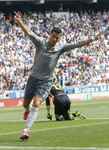Real Madrid's Cristiano Ronaldo celebrates a goal against Espanyol during their Spanish first division soccer match in Cornella de Llobregat, near Barcelona, Spain, September 12, 2015. REUTERS/Albert Gea