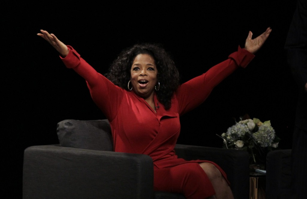 "Oprah Winfrey acknowledges the audience after she came to the stage for an interview with Ball State University alumnus David Letterman, host of CBS's ""Late Show,"" at Ball State University in Muncie, Ind., Monday, Nov. 26, 2012. The conversation is part of the David Letterman Distinguished Professional Lecture and Workshop Series. (AP Photo/Michael Conroy) ORG XMIT: INMC105 ORG XMIT: POS1211261644515222"
