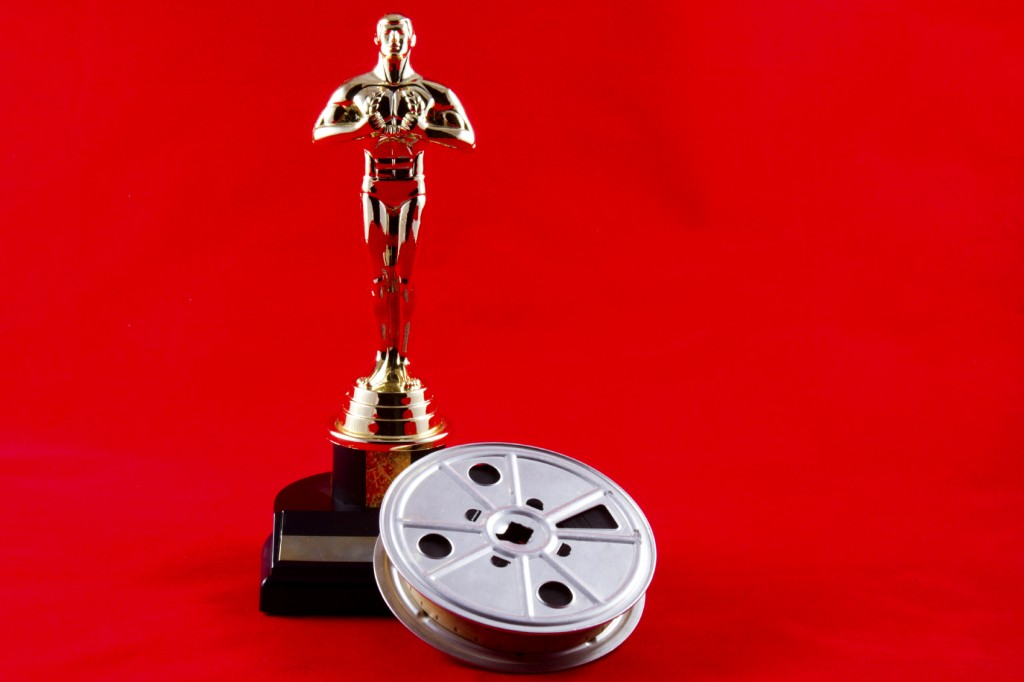 Oscar Statuette with Movie Reel