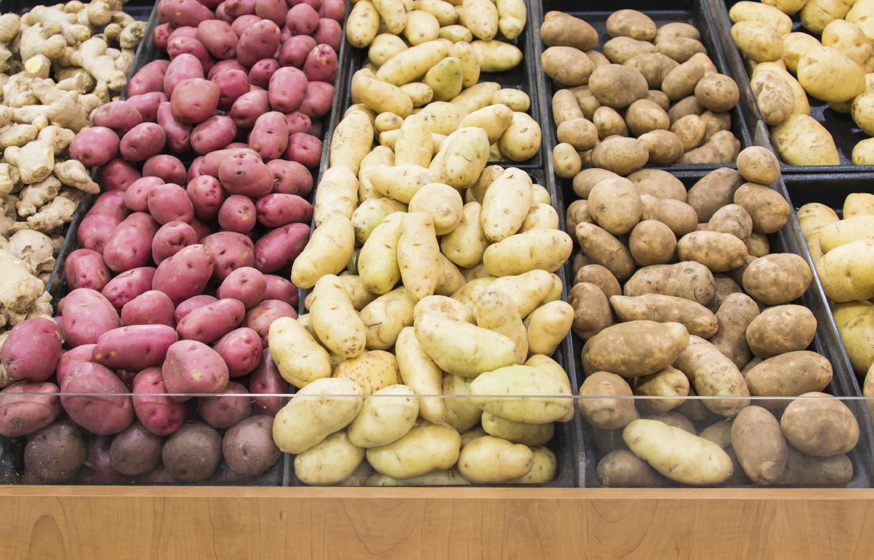 Different colors potatoes in a grocery store