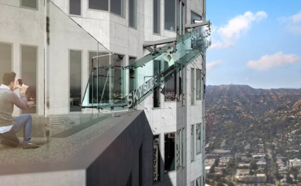 LOS ANGELES -- The downtown Los Angeles skyline is about to get a whole lot more exciting -- and possibly a little scary for anyone afraid of heights.  CBS Los Angeles reported the U.S. Bank Tower, the tallest building west of the Mississippi, is getting a scream-inducing new tourist attraction called Skyslide.  The 36-foot-long glass slide will allow thrill-seekers to slide from the 70th floor down to the 69th floor on the outside of the building.    The slide is about 1,000 feet above ground and will give sliders quite the view down. A new observation deck and upscale restaurant are being added on the 71st floor, offering views from the hills of Glendale to Catalina.  Organizers expect tickets to run about $25 for the slide and observation deck once the attraction opens by the middle of this year.