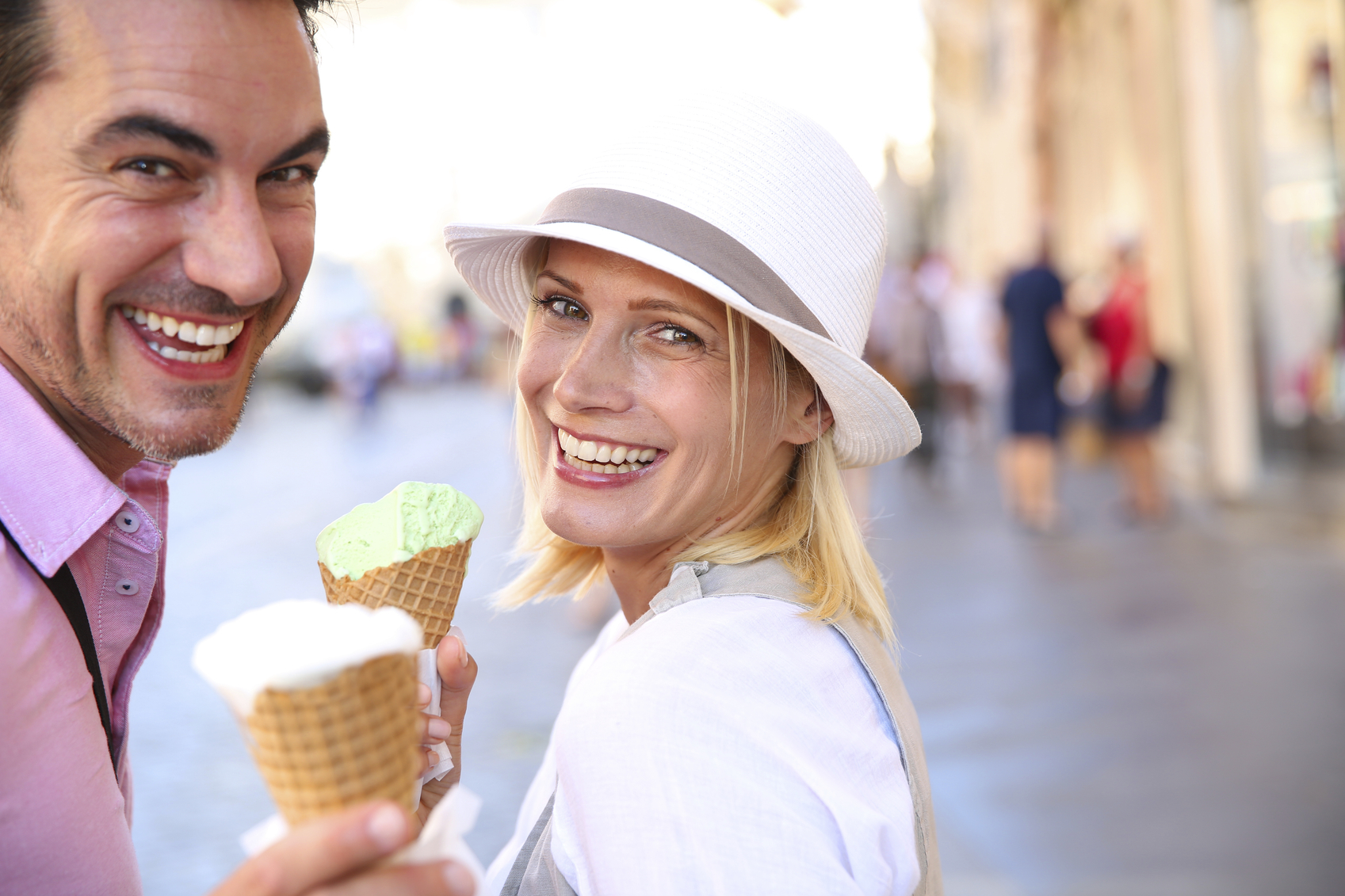 Tourists in a street of Rome eating ice cream