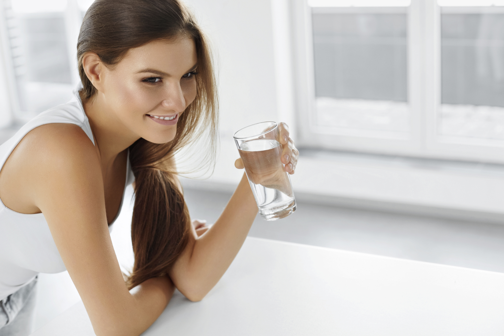 Healthy Lifestyle. Happy Woman With Glass Of Water. Drinks. Heal