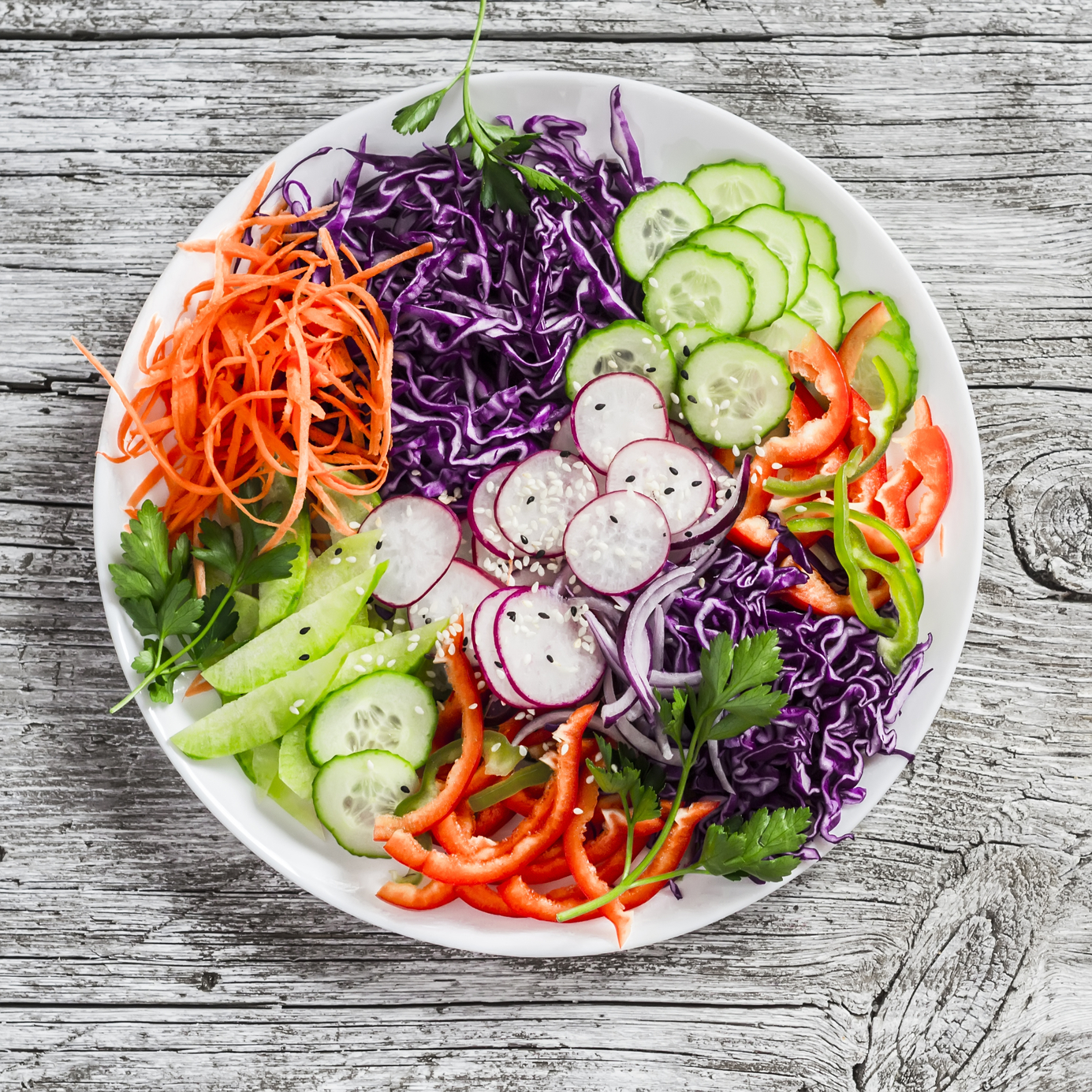 vegetable salad with red cabbage, cucumber, radish, carrots, sweet peppers