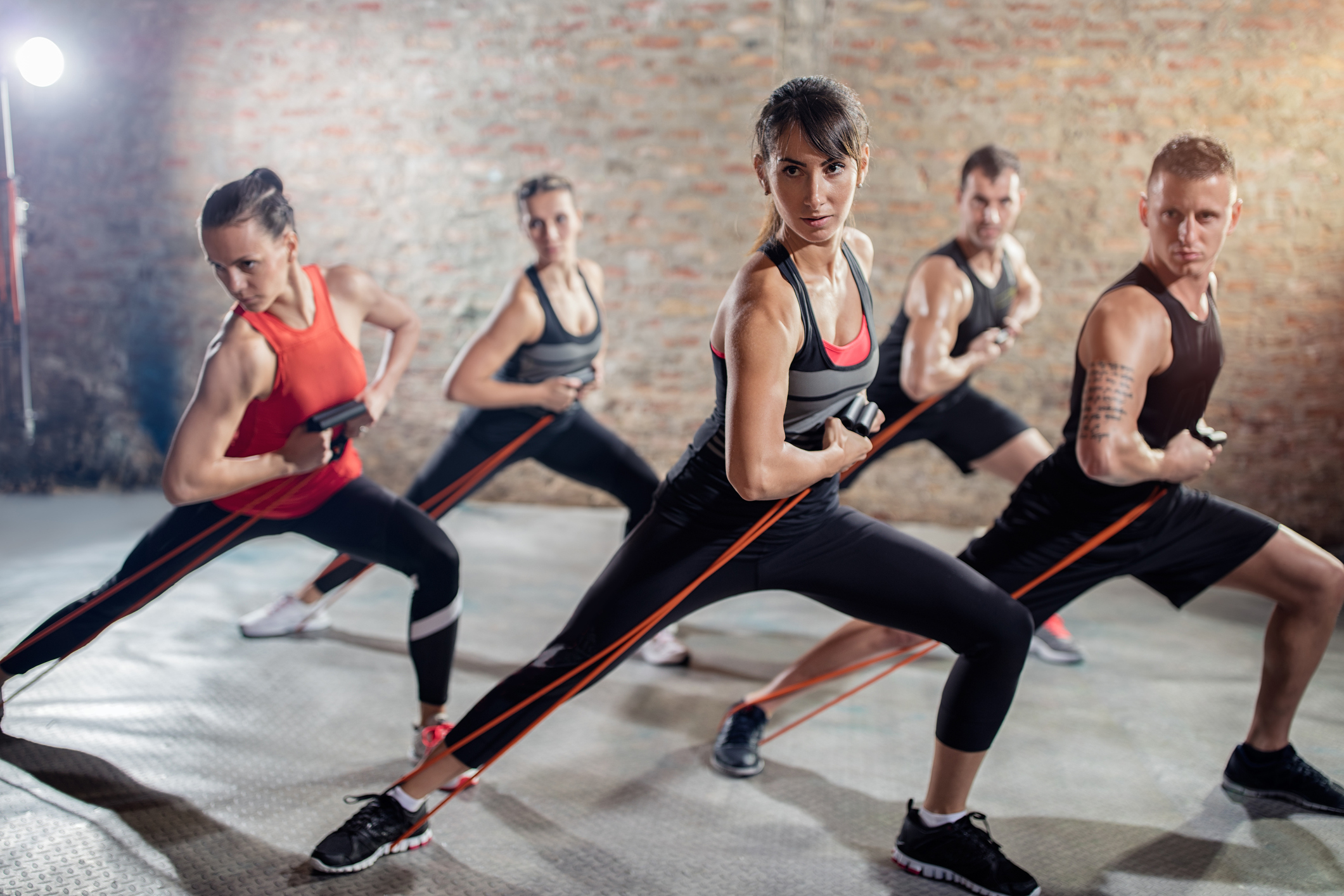 healthy people on group training with resistance band