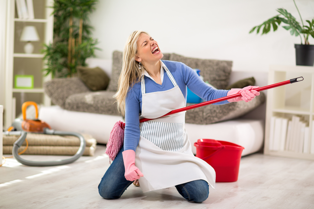 Funny female make joke while cleaning house